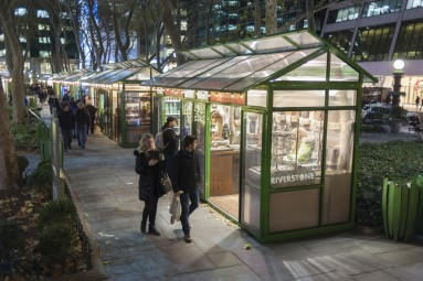 Visitors stroll through the Bryant Park Holiday Market