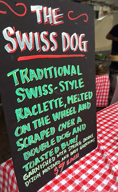 menu sign for the Raclette Swiss Dog